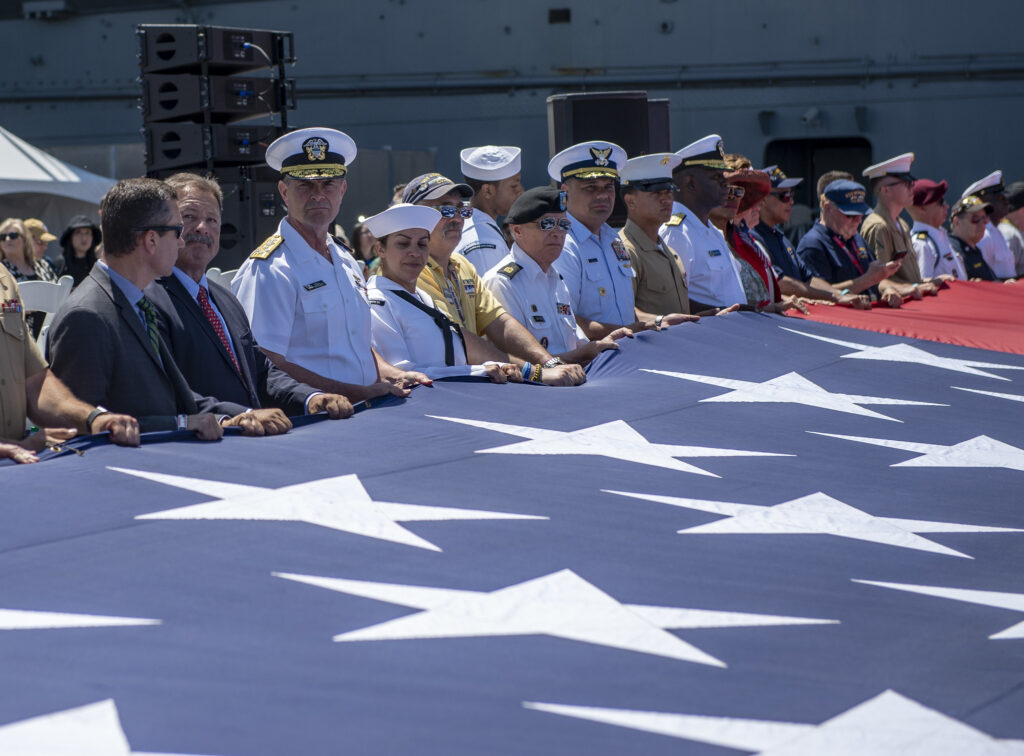 Vice Chief of Naval Operations holds the national ensign